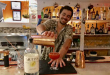 Carson Delledonne mixes up a cocktail with Mutiny Island Vodka behind the bar at 40 Stand Eatery.