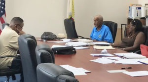Without a quorum, Board of Elections members go over voter registration issues at a meeting last week.