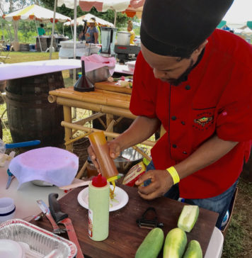 Kimba Kabaka pepares his prize-winning dish, a slice of roasted breadfruit topped with ackee and a spinach ricotta sauce.