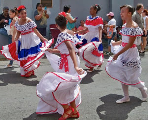 In 2013, the V.I.-Puerto Rico Friendship parade swirls colorfully down the streets of CHristiansted on the way to the Canegata Ballpark. (File photo)