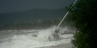 A boat is driven ashore by the winds of Hurricane Earl in 2010. Extreme weather may come more frequently but less predictably to the territory under worst-case predictions in the National Climate Change report, released last week. (File photo)