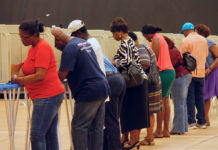 Voters fill rows of privacy booths at the UVI polling site.