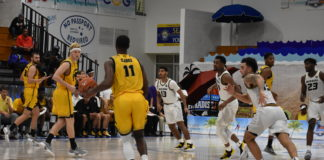 Kyle Clarke, No. 11, dribbles the ball upcourt for Kennesaw State in its opening round loss to Missouri. Clarke represented the Virgin Islands during summer's CAC Games and finished Friday with 10 points.