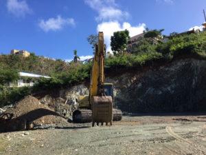 A backhoe clears Tier 2 property in Cruz Bay in January.