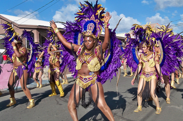 A dance troupe glitters in the sun during the 2015-2016 Crucian Christmas Festival Adult Parade. (Source file photo)