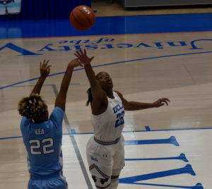 Paris Kea knocks down a three pointer over a UCLA defender in the first half of UNC's victory at the UVI Sports and Fitness Center.