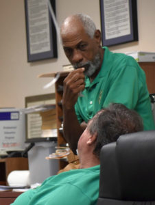 """Board of Elections members Arturo Watlington Jr. and Robert """"Max"""" Schanfarber take a break while counting votes after the general election."""
