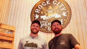 "Rock City Brewing owners Joe, left, and John Brugos currently sell Hull Bay Lager at ""The Beer Barn,"" pictured here, and Tap & Still."
