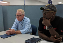 Governor-elect Albert Bryan Jr. receives a briefing on the hurricane recovery effort at the FEMA Joint Field Office in St. Croix on Dec. 8. (Photo from the office of Governor-elect Albert Bryan)