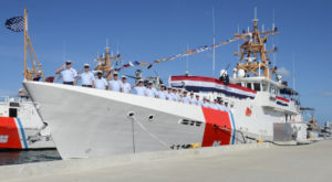 The crew of the Coast Guard Cutter Joseph Napier salute during the commissioning ceremony in 2016. (U.S. Coast Guard photo by Petty Officer 2nd Class Mark Barney)