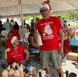 Heather Grant assists Stuart Locklair at his Coquito Festival debut, 2018. (Anne Salafia photo)