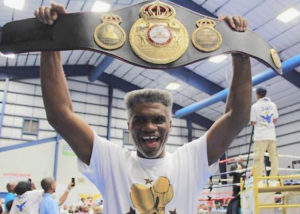 In this 2017 photo, three-time world boxing champion Julian 'The Hawk' Jackson of the USVI holds aloft a replica of his first world-title belt he had just been presented.