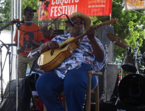 "Wayne ""Bully"" Petersen of Bully and the Kafoonaz lures fans at the 11th annual Coquito Festival. (Anne Salafia photo)"