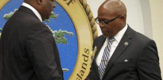 New Senate President Kenneth Gittens prepares to take the gavel from former Senate President Myron Jackson.