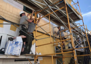 From left, William Cardis, Travis Haymaker, Gary Zbel, Jeff Dennison work on the historic Scale House. Elisa McKay photo)