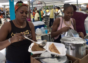 At the 2019 Folklife Festival, twins Luciah Polius and Loreli Hedrington serve up food as their grandmother and great aunt did for 20 years. (Source file photo)