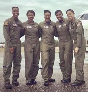 The 'Fab Five,' the Coast Guard's five black female pilots, from left, Lt. Cmdr. Jeanine Menze, Lt. Cmdr. LaShanda Renee Holmes, Lt. C. Angel Hughes, Lt. Chanel Lee and Lt. Ronaqua Russell. (U.S. Coast Guard photo)