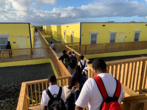 Students head for their new homerooms at Arthur Richards Jr. High on their first day back on their own campus. (Anne Salafia photo)