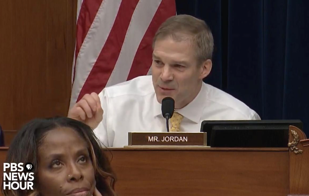 Delegate to Congress Stacey Plaskett rolls her eyes at Rep. Jim Jordan during the Michael Cohen hearing Wednesday. The video clip went viral.