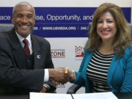V.I. EDA Chief Executive Officer Kamal Latham and SBA District Director Yvette Collazo make official a two-year partnership that starts with the development of a strategic plan for local small business development.