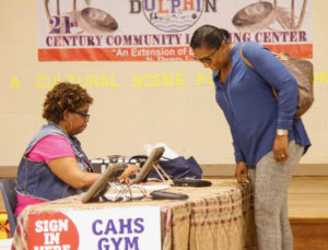A Joseph Sibilly poll worker answers a questions from a lone voter.