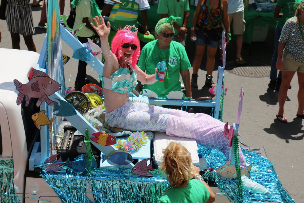 A mermaid blows bubbles as the St. Patrick's Parade rolls through town. (Linda Morland photo)