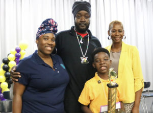 Cairo Leonard with parents and coach. (Photo submitted by VIDE)