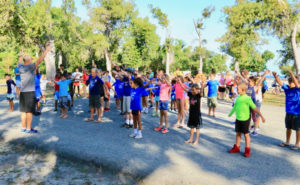 Before the race, competitors warm up with Dr. Brad Koepel. (Photo provided by Al LaBorde)