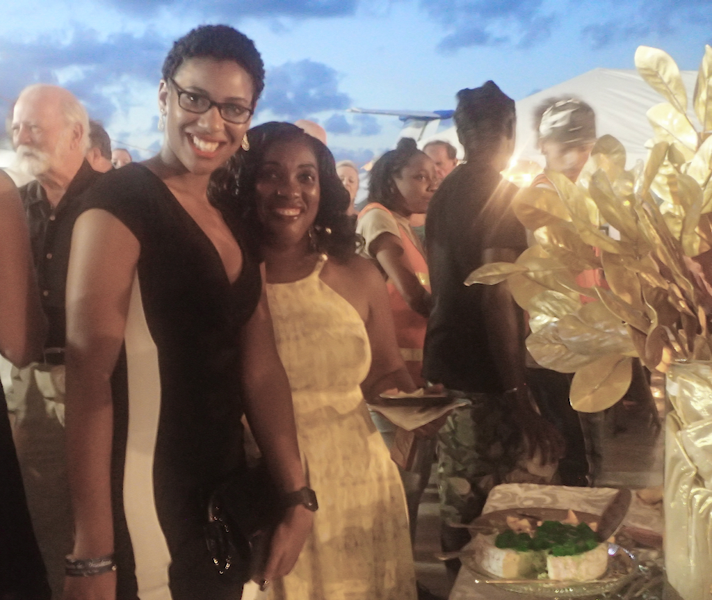 Service member daughter and mother, Nisha and Claver Lazare, enjoy an evening of food and wine. (Susan Ellis photo)