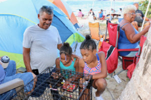 Miguel Rentas enjoys time with granddaughters, Ivelisse Major and Solys Major, as family matriarch Cruz Delgado relaxes behind them. The last week was the first traditional Easter Campign for Ivelisse and Solys. (Linda Morland photo)