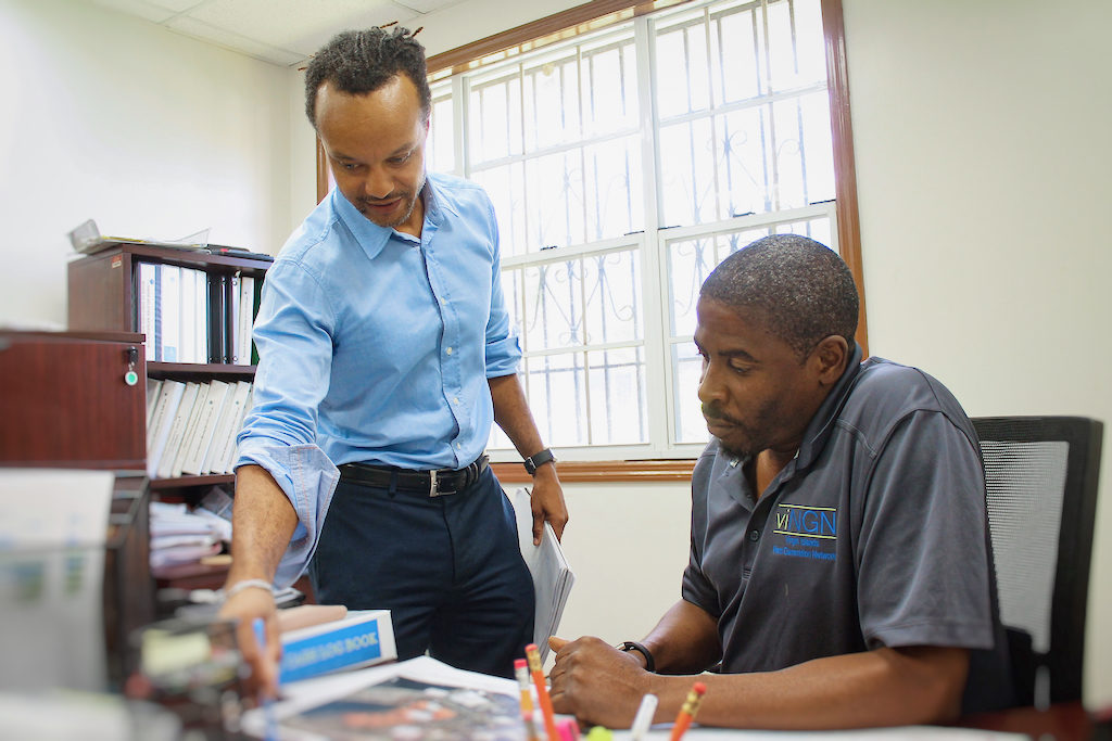 viNGN Chief Information Officer Daryl Wade, left, pores over a map with lead field technician Celestino White Jr.