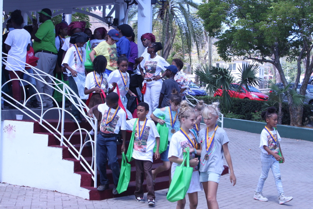 Students from a dozen schools scramble down the gazebo stairs in the Emancipation Gardens after receiving their participation medals and goodie bags. (Bethaney Lee photo)