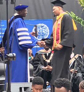 UVI President David Hall, not a short man, congratulates the 6-foot-5 Samuel Liburd Jr at the UVI commencement ceremony. (Photo provided by Dayle Berry)