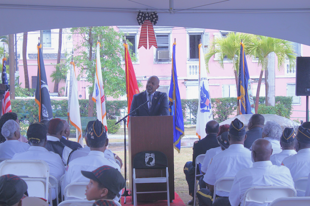 V.I. Lt. Gov. Tregenza Roach speaks to an audience of nearly 75 onlookers who have come to observe Memorial Day.