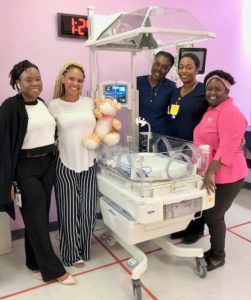 "JFL Hospital staff, from left, K. Davis, RN with unit mascot ""Jeffery,"" J. Jeffers, RN, D. Ebbeson, RN and B. Abraham, pose with recently acquired incubator for the neonatal intensive care unit. (Submitted photo)"