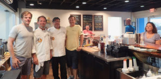 Jeff Sanford, Brandt Pell, Todd Manley and Art Wollenweber greet customers at the opening day of the Sion Farm Distillery. (Susan Ellis photo)