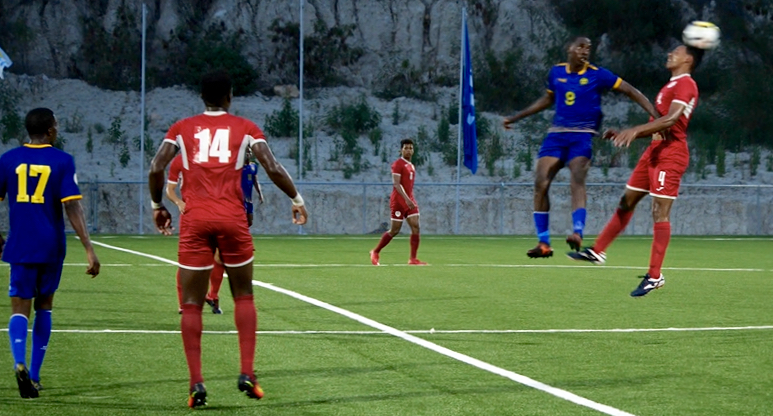 Cuba and Barbados battle for possession. (Source photo by Kyle Murphy)