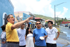 Sperry tells Kavita Goel, Ajay Goel and the Pandya family about Charlotte Amalie's waterfront, chronicling various important moments of the island's past. (Source photo by Bethaney Lee)