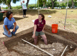 Archaeological technician Amelia Jansen of the National Park Service Southeast Archaeological Center talks about the excavation of what might have been a utilitarian area for holding water, perhaps for watering livestock or washing clothes. As the NPS is able to receive grants, the progress of unearthing this part of Crucian history will continue. (Source photo by Linda Morland)