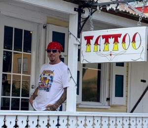 John Turner rests outside his shop, Freedom City Tattoo at 21 Strand Street, Frederiksted. (Source photo by Denise Lenhardt-Benoit)