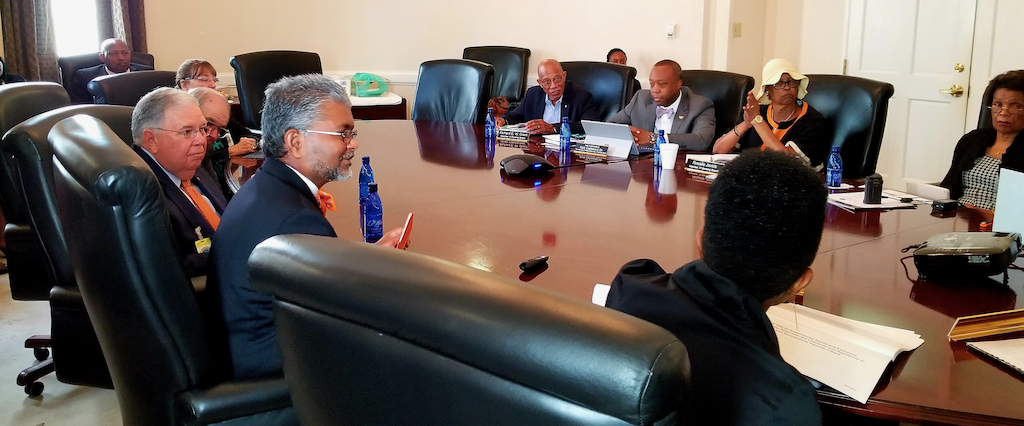 A panel of Oriental Bank representatives meet with the Virgin Islands Banking Board to discuss their request of a permit. (Source photo)