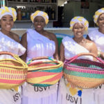 The Caribbean Ritual Dancers posse with their baskets. (Source photo by Amy Roberts)