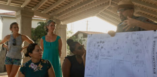 VINP Ranger Dave Worthington explains a drawing of the plans while Chelsea Baraowski and Tonia Lovejoy,, standing, and Zarah Rose and Crystal George, seated, look on. (Source photo by Amy Roberts)