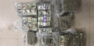 Bundles of vaccuum-packed cash found by federal agents on a beached boat on St Thomas. (Customs and Border Patrol photo)