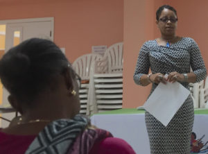The St. Croix Long Term Recovery Group's Delia Richardson, leads a town hall meeting Monday. (Source photo by Susan Ellis)