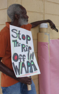 A protester signals his dissatisfaction with WAPA during a PSC meeting in August. (Source file photo by Bethaney Lee)