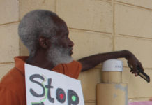 A protester signals his dissatisfaction with WAPA. (Source photo by Bethaney Lee)