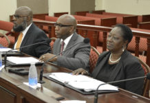 From left, USVI Housing Finance Authority Chief Operating Officer Darin Richardson, Executive Director Daryl Griffith, and Chief Financial Officer Valdez Shelford testify before the Senate Finance Committee. (Photo by Barry Leerdam, USVI Legislature)