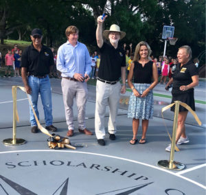 Head of School William Bugg cuts the ribbon with a flourish, planed by, from left, Felix Lima, Joseph Croney, Robyn Falsoner and Amy Carter. (Source photo by Elisa McKay)