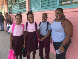 Empress, Princess & Eyan with mother Letitia Henry are ready to get back to school. (Source photo by Elisa McKay)